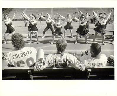 Tony Colorito, Bruce Klosterman and Cameron watch The Orange Coast College Cheerleadres 1987 Denver Broncos Original Press Photo / Wire Photo w/ Photographer Stamp on Back 8x10