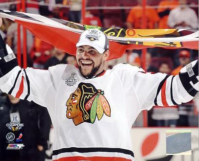 Dustin Byfuglien With Blackhawks Flag 2010 Stanley Cup Finals Chicago Blackhawks 8x10 Photo